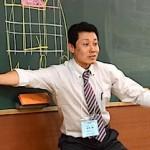 数学の部門別決勝戦で模擬授業をする練成会グループの田中博先生