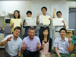 社内表彰式の様子(前列左から2番目が志賀明彦社長)